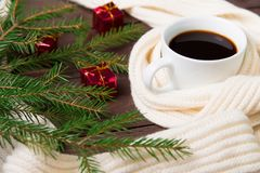 Christmas coffee with a warm scarf and Christmas decorations. On wooden background. Christmas morning Stock Images
