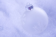 Christmas cold background. With snow and christmas balls (selective focus Royalty Free Stock Photos