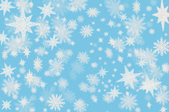 Christmas cold blue background with snow flakes and stars with b. Lurred Royalty Free Stock Photos