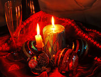 Christmas collage. With burning candles, decorative balls and glass Stock Image