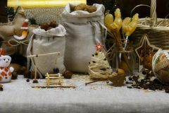 Christmas collage - bags with nuts, lollipops, Christmas tree and wooden models royalty free stock photos