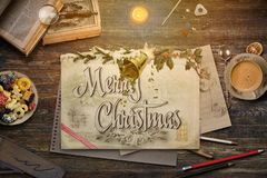 Christmas collage with pencils, drawing, books and holly on a vi stock images