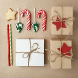 Christmas collection with candy canes, straw, marshmallow, cookie star, gift boxes for mock up template design on craft paper back stock images