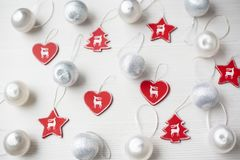 Christmas Ornaments on background. Christmas collection, decorative ornaments, on wood background Royalty Free Stock Photography