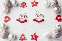 Christmas Ornaments on background. Christmas collection, decorative ornaments, on wood background Stock Images
