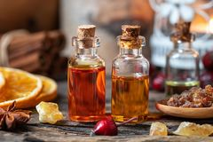 Christmas collection of essential oils with frankincense, myrrh, rose hips and orange slices. Christmas collection of essential oils with myrrh, frankincense stock photos