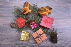 Christmas collection, gifts box, tree and decorative ornaments, on rustic wood. Christmas collection, gifts box, tree and decorative ornaments, on rustic wood Stock Photography