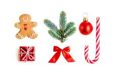 Christmas collection with gifts, fir tree, gingerbread man cookie and ornaments isolated on white background close up. Flat. Lay, top view royalty free stock images