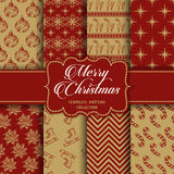 Christmas Collection of seamless patterns with red and golden colors Stock Images