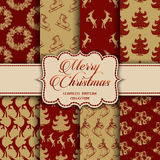 Christmas Collection of seamless patterns with red and golden colors. Vector illustration for your design Royalty Free Stock Image
