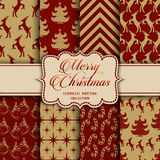 Christmas Collection of seamless patterns with red and golden colors. Vector illustration for your design Stock Photos