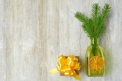 Christmas collection of tree branches, cones, green bottles, ora stock image
