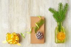 Christmas collection of tree branches, cones, green bottles, ora stock images