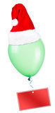 Christmas on color balloon with santa hat Royalty Free Stock Photos