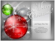 Christmas color baubles with snowflake & text Stock Photography