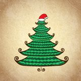 Christmas color tree with Santa cap Royalty Free Stock Photo
