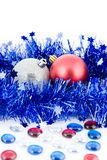 Christmas colored balls in blue tinsel Royalty Free Stock Photography