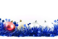 Christmas colored balls in blue tinsel Royalty Free Stock Image