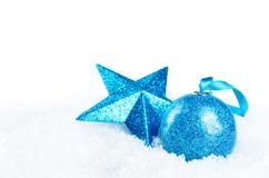 Christmas colored balls with star on snow isolated background royalty free stock photo