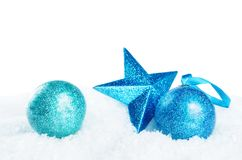 Christmas colored balls with star on snow isolated background stock image