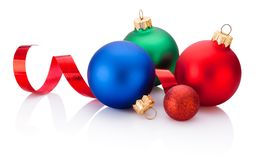Christmas colored baubles and curling paper Isolated on white ba. Christmas colored baubles and curling paper Isolated on a white background royalty free stock photography