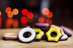 Christmas colored candy on a bokeh background. Pink,yellow and white colors stock images