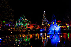 Artistic Christmas colored lights reflected in pond Stock Images