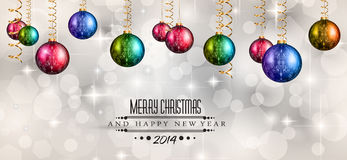 2014 Christmas Colorful Background. With a waterfall of ray lights and a lot of baubles and stars Stock Photos