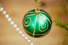 Christmas colorful ball decorate on pine tree red vintage tone background for New Year festival. Royalty Free Stock Photo
