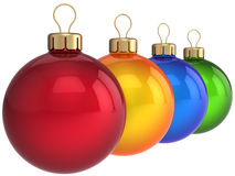 Christmas colorful balls (Hi-Res). Four multicolored (red, orange, blue, green) shining christmas balls (baubles). This is a detailed 3D render. Isolated on Stock Photo