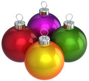 Christmas colorful baubles (Hi-Res). Four multicolored shining christmas balls (baubles). This is a detailed 3D render. Isolated on white Stock Photo