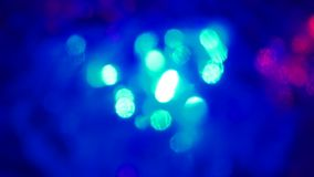 Christmas colorful bokeh with neon lights. Abstract blurred background with blinking pink green red flashlights.