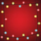 Christmas Colorful Bulb Garland on Red  Background Stock Images