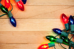 Christmas: Colorful Christmas Light Background. Background series of Christmas related items with lots of copyspace, on a wooden table setting Royalty Free Stock Photography
