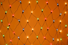 Christmas colorful garland fishnet background Royalty Free Stock Photography