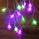 Christmas colorful garland lights on wooden rustic background. filtered image. Royalty Free Stock Image