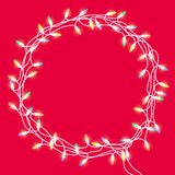 Christmas colorful garland. Christmas wreath or frame of colorful garland with glowing bright lights on a red background. Isolated. Hand drawn vector Stock Photos