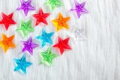 Christmas colorful glass stars over white fur Stock Photography