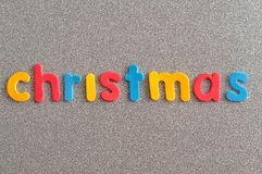 Christmas in colorful letters. On a silver background Royalty Free Stock Photography