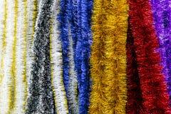 Christmas colorful shiny tinsel and garlands Royalty Free Stock Photos