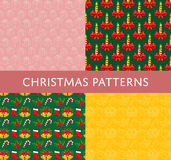 Christmas Colorful Vector Seamless Patterns Set. Christmas seamless patterns. Colored and line gift, candle, stocking sock, candy cane, bells vectors on color Stock Images