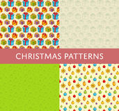 Christmas Colorful Vector Seamless Patterns Set. Christmas seamless patterns. Colorful and line gifts, ball toys for Christmas tree decoration vectors on color Royalty Free Stock Image