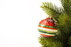 Christmas colorfull ball on the Christmas tree on light background Royalty Free Stock Photo