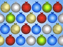 Christmas coloured baubles on blue Royalty Free Stock Photography
