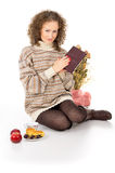 Christmas, comfort, girl with a book Royalty Free Stock Photo