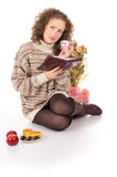 Christmas, comfort, girl with a book resting Royalty Free Stock Photography