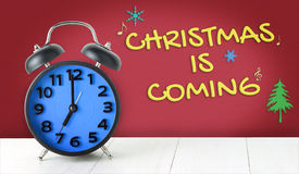 Christmas coming with blue alarm clock Stock Photos