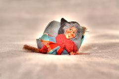 The befana, a typical Italian tradition, the witch on the broom flying to the epiphany, and takes away all the Christmas holidays. Christmas is coming and the royalty free stock image