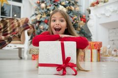 Christmas is coming. Small cute girl received holiday gift. Best christmas gifts. Kid little girl in elegant dress and stock photos