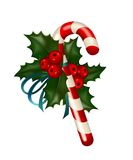 Christmas composition. Christmas sugar candy decorated with holly on white background Royalty Free Stock Photography